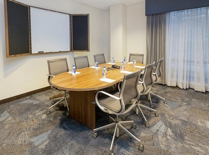 Boardroom with Meeting Table, Office Chairs and Whiteboard