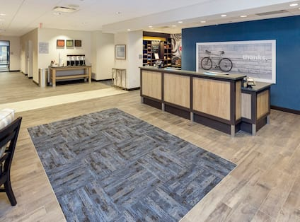 Front Desk Reception Area with Coffee Station and Snack Shop