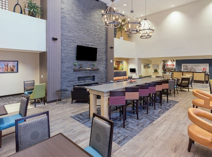Breakfast Dining Area with Chairs, Tables and Wall Mounted HDTV