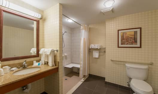 Bathroom with toilet, sink and mirror