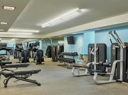 Fitness center with resistance machines and benches