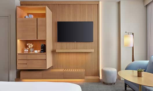 Bed in room with TV