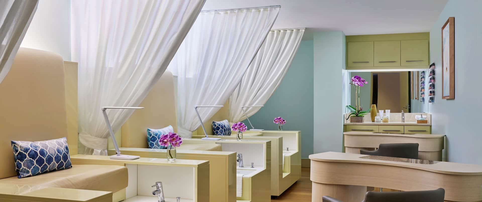 Spa treatment room with sinks and chairs