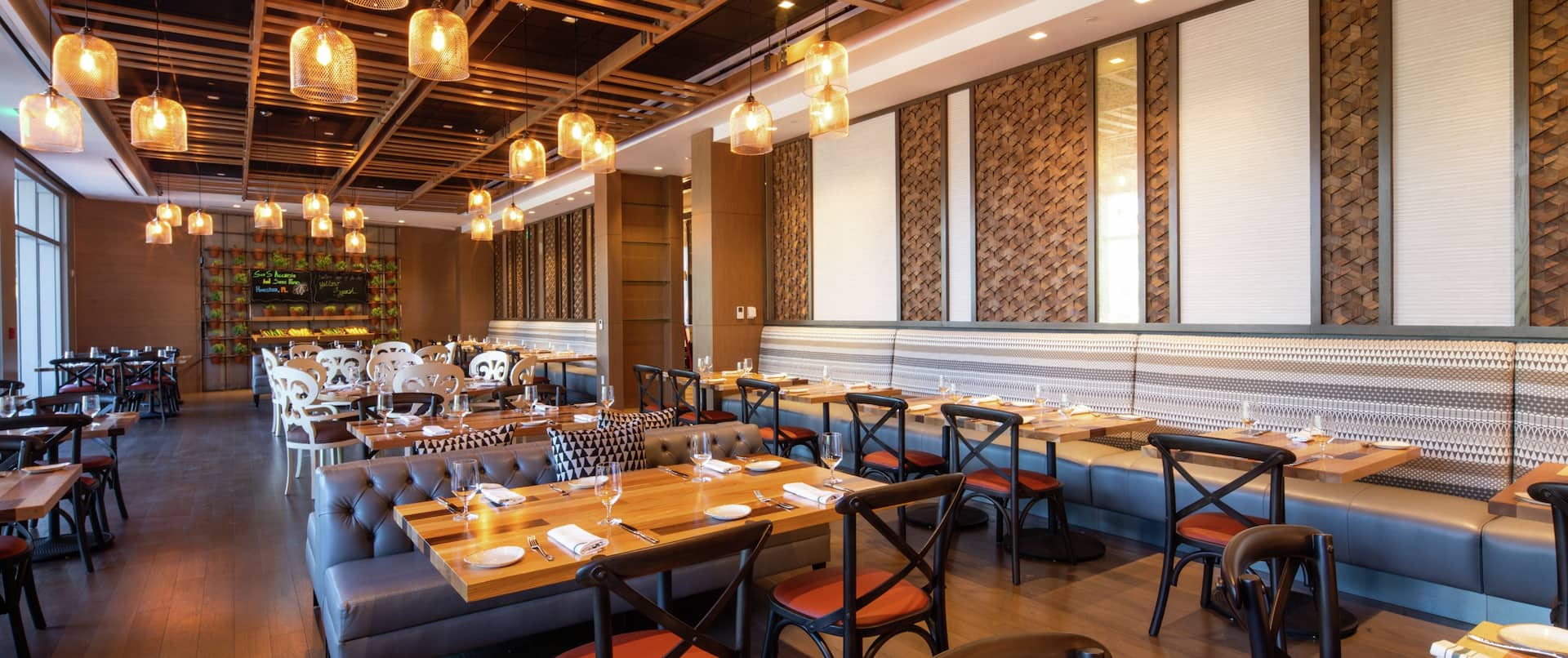 Table 55 Restaurant with wooden tables and blue banquette seating