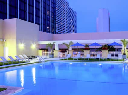 View of Outdoor Pool Area in the Evening