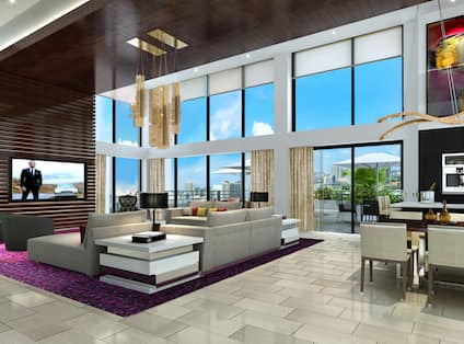 Seating and Table in Large Suite Living Room with Floor-to-Ceiling Windows