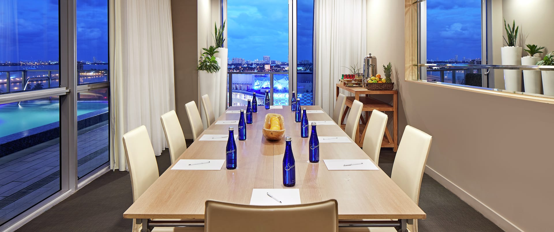 Boardroom with Table, Chairs, and Outside View