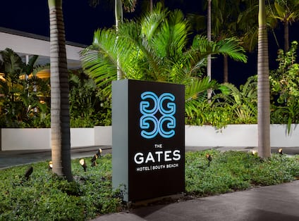 Hotel Exterior The Gates Sign at Night