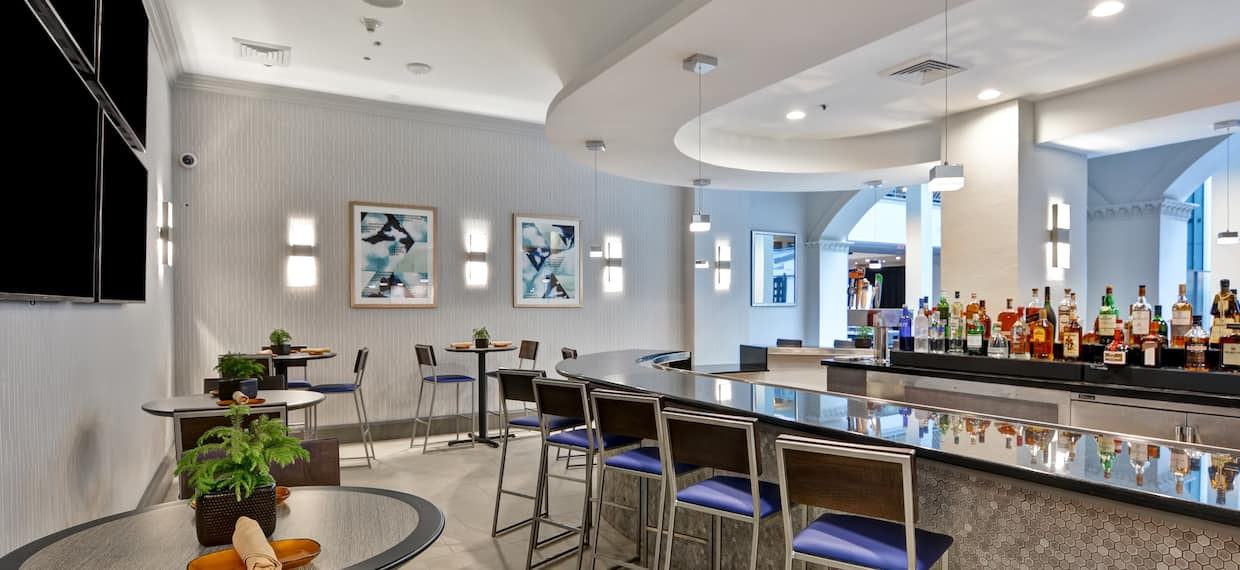 Bar Lounge Area with Bar Counter and Bar Stools