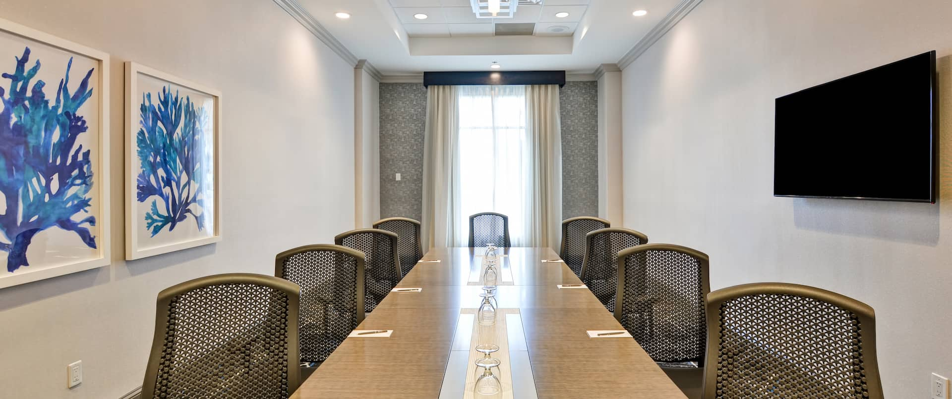 Boardroom with Conference Table and Wall Mounted Television