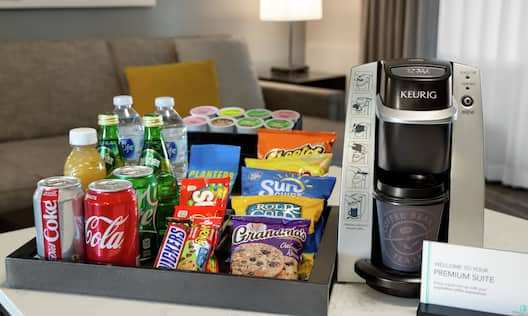 Premium suite amenities featuring complimentary coffee, snacks, and cold bevereages.
