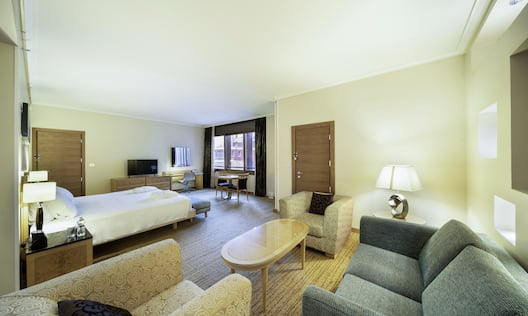 King Junior Suite with Bed, Lounge Area, Work Desk, Outside View, and Room Technology