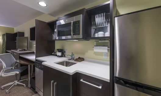 Suite kitchen area with microwave and sink