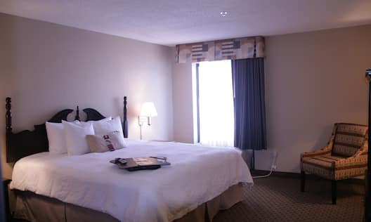 Hospitality Guest Suite with King Bed and Chair