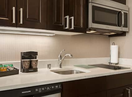 Suite Kitchen with Sink and Microwave