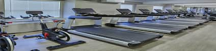Fitness Center with Treadmills and Exercise Equipment