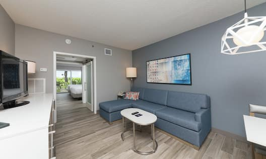Double Queen, First Floor, Patio Suite, Living Area with Couch Sleeper Sofa