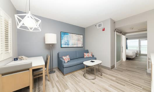 Double Queen Accessible Suite, Living Area with Couch Sleeper Sofa