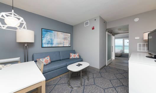King Accessible Suite with Roll in Shower with Balcony, Living Area with Couch Sleeper Sofa