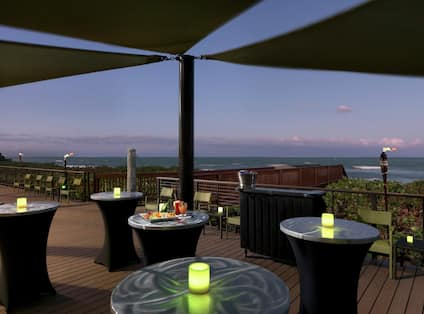 Oceanview Deck at Night with Tables and lights