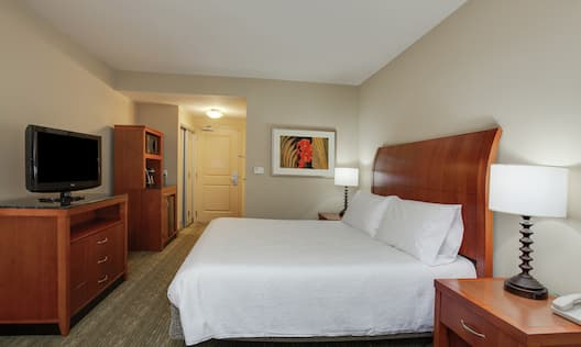 Guestroom With King Bed, Kitchenette, And Room Technology