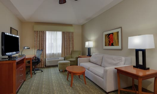 Guestroom Suite Living Area with Sofa, Lounge Area, Work Desk, and Room Technology