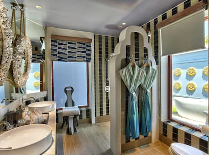 Beach Villa Bathroom with Mirrors, Dual Vanity, Robe, and Walk-In Shower