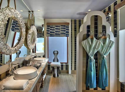 Beach Villa Bathroom with Mirrors, Dual Vanity, Robes, and Walk-In Shower