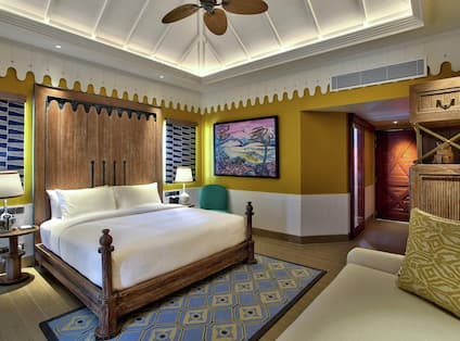 Beach Villa Bedroom with Bed and Lounge Area