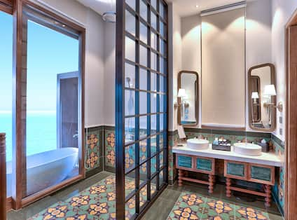 Overwater Villa Bathroom with with Bathtub and Vanity Area