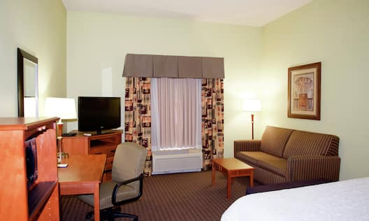 King Study Guestroom with Bed, Lounge Area, Work Desk, and Room Technology