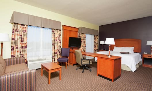 King Studio Suite with Bed, Lounge Area, Work Desk, and Room Technology