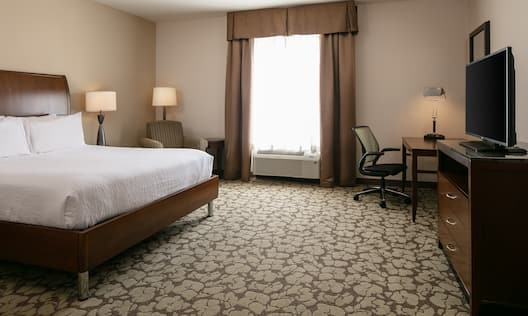 King-Sized Guestroom with Lounge Area, Work Desk, and Room Technology