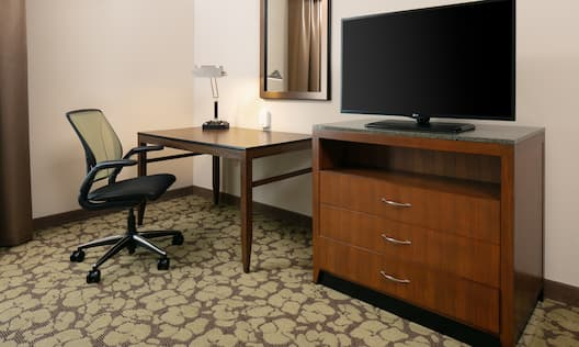 King-Sized Guestroom with Room Technology and Work Desk