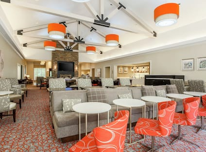 Lobby Seating Area with Large Sofa Round Table and Chairs