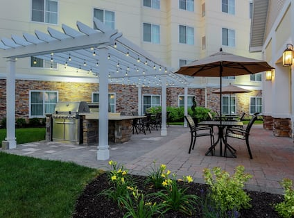 Outdoor Patio with Grills and Tables Covered with Umbrellas