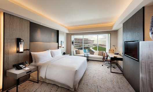 Deluxe Guestroom with Bed, Room Technology, Lounge Area, Work Desk, and Outside View