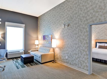 One King Bed Guestroom Living Room Area with Sofa and Work Desk