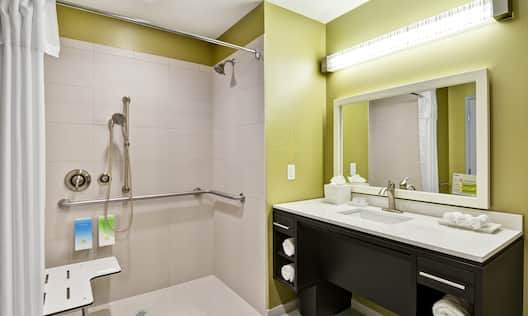 Accessible Guest Bathroom with Roll-In Shower with Vanity