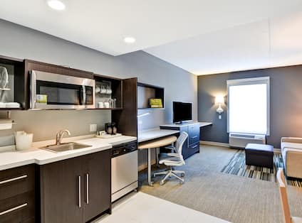 Guestroom Suite Kitchen and Living Area with Work Desk and HDTV
