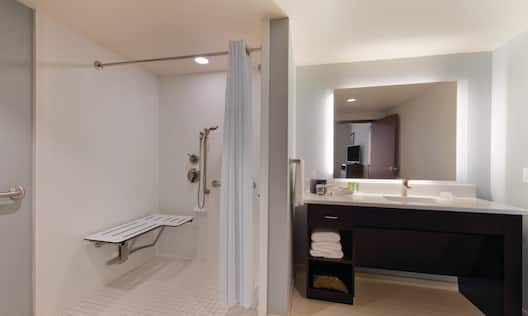 Accessible Bathroom with Roll-In Shower and Bench