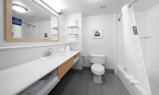 Bathroom with sink, toilet and mirror