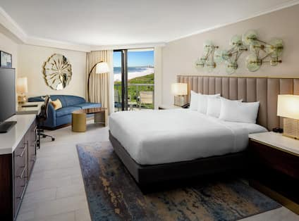 Deluxe Ocean View Room with King Bed, Sofa, and HDTV