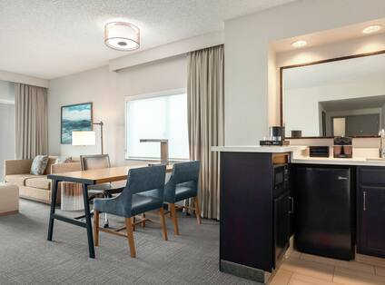 Spacious living area in corner PURE suite featuring wet bar, beautiful view and balcony.
