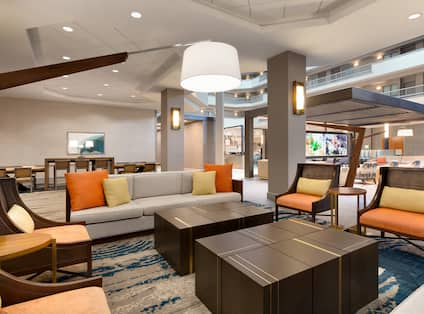 Lobby Seating Area with Sofa, Armchairs and Tables