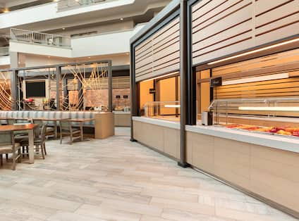Breakfast area with buffet-style breakfast and seating