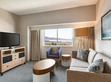 Lounge area with TV and seating