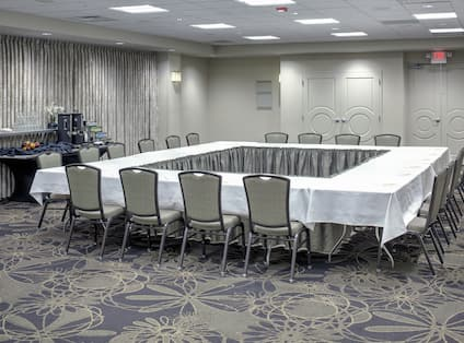 Meeting Room with Hallow Square Setup