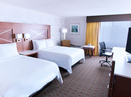 Guest Room with Double Queen Beds, Television and Work Desk