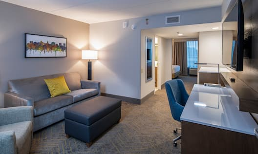 Suite Living Area with Desk and HDTV